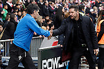 Atletico de Madrid's coach Diego Pablo Simeone (r) and Sociedad Deportiva Eibar's coach Jose Luis Mendilibar during La Liga match. February 6,2016. (ALTERPHOTOS/Acero)