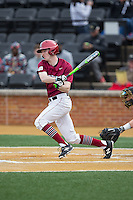 Josh Ellis (9) of the Harvard Crimson follows through on his swing against the Wake Forest Demon Deacons at David F. Couch Ballpark on March 5, 2016 in Winston-Salem, North Carolina.  The Crimson defeated the Demon Deacons 6-3.  (Brian Westerholt/Four Seam Images)