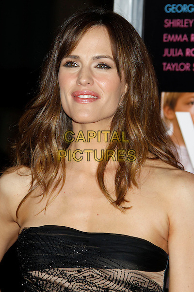 "JENNIFER GARNER .""Valentine's Day"" Los Angeles Premiere - arrivals held at Grauman's Chinese Theatre, Hollywood, California, USA, .8th February 2010. .portrait headshot black strapless smiling beaded beige .CAP/ADM/MJ.©Michael Jade/AdMedia/Capital Pictures."