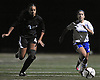 Nassau Team No. 7 Ariel Uzan (Great Neck North HS), right, gets pressured by Suffolk Team No. 4 Jacy Lawrence (Patchogue-Medford HS) during the first of two Long Island varsity girls' soccer senior all-star games at Bethpage High School on Friday, November 27, 2015.<br /> <br /> James Escher
