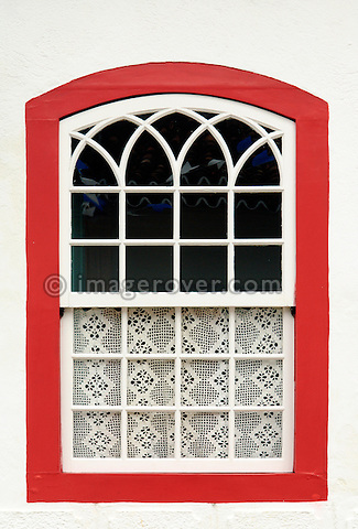 Lovingly decorated house window in Paraty's historic center; Paraty, Espirito Santo, Brazil. The beautiful colonial town of Paraty has been a UNESCO World Heritage Site since 1958. --- No signed releases available.