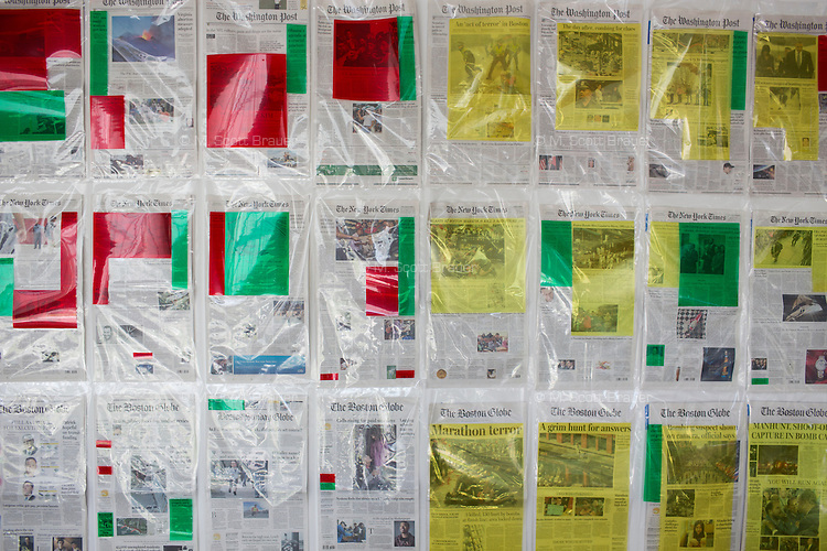 A display of newspaper front pages analyzed by the PageOneX.com project hangs in a common area of MIT's Media Lab in Cambridge, Massachusetts, USA.  Colors mark different types of stories published by the newspaper: green indicates a story about guns, red indicates war, and yellow indicates terrorism. The project is part of the Civic Media group at the Media Lab and was started by Ahmd Refat and is now developed by the Center for Civic Media by Edward L Platt, Rahul Bhargava and Pablo Rey Mazon.