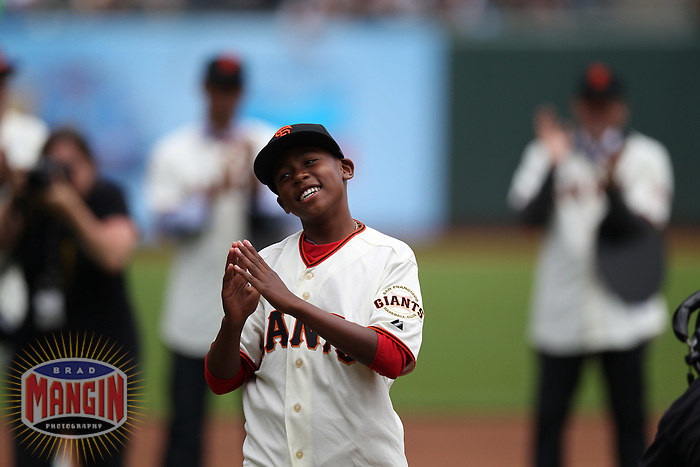 SAN FRANCISCO, CA - JULY 1:  Darren Baker, son of Manager Dusty Baker #12 of the Cincinnati Reds wears a San Francisco Giants jersey and hat during and reacts during on field ceremonies honoring the Giants 2002 National League Championship team that Baker managed. Darren Baker threw out the first pitch before the game against the San Francisco Giants at AT&T Park on Sunday, July 1, 2012 in San Francisco, California. Photo by Brad Mangin