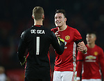 Phil Jones of Manchester United celebrates with David De Gea of Manchester United during the English League Cup Quarter Final match at Old Trafford  Stadium, Manchester. Picture date: November 30th, 2016. Pic Simon Bellis/Sportimage