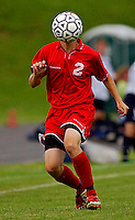Fauquier's Jason Sprecher turns his head into a soccer ball, attempting to sneak past the Harrisonburg defense, but the trick didn't work and Fauquier fell to Harrisonburg 2-1 in regional state playoffs May 31, 2004 at Harrison Middle School in Harrisonburg, VA.