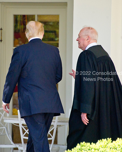 United States President Donald J. Trump speaks with Associate Justice of the US Supreme Court Anthony Kennedy as they walk on the Colonnade following the Oath of Office ceremony for new Associate Justice in the Rose Garden of the White House in Washington, DC on Monday, April 10, 2017.<br /> Credit: Ron Sachs / CNP<br /> (RESTRICTION: NO New York or New Jersey Newspapers or newspapers within a 75 mile radius of New York City)