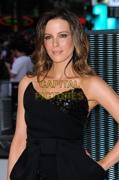 Kate Beckinsale.'Total Recall' UK Film Premiere arrivals, Vue Leicester Square, London, England..August 16th, 2012.half length black dress strapless sequins sequins bow-cinched waist hand on hip     .CAP/CJ.©Chris Joseph/Capital Pictures.