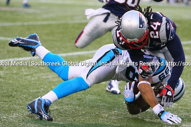 13December2009: New England Patriot cornerback Jonathan Wilhite #24 upends Carolina Panther wide receiver Steve Smith #89. The New England Patriots defeated the Carolina Panthers 20-10 at Gillette Stadium in Foxborough, Massachusetts.