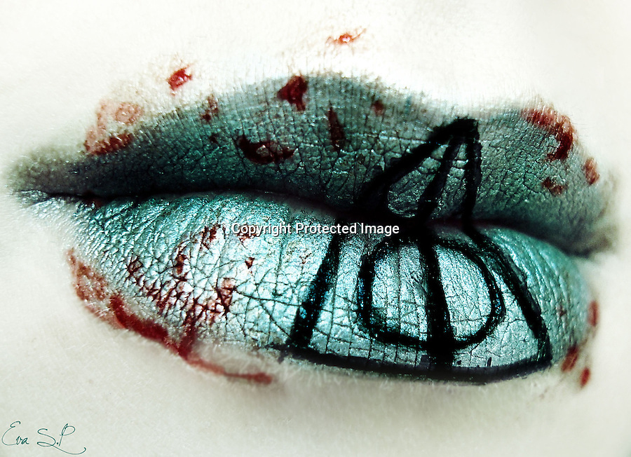 BNPS.co.uk (01202 558833).Pic: EvaSenin/BNPS..***Please use full byline***..Lips, camera, action!..A talented make-up fanatic has recreated such recognisable scenes from her favourite films on her lips that she has left her friends gobsmacked...Eva Senin Pernas, 26, started practising with make-up when she was a teenager but became inspired to create wacky movie-themed designs while watching television...She takes an iconic idea from a film and transfers it to her lips by puckering up and painting them with the bright colours...Some of Eva's lip designs include the Deathly Hallows symbol from the Harry Potter series and a sunset scene from Disney's Lion King...Creative Eva has now moved onto other ideas including a set of fruit designs with miniature lemons, oranges, and limes, and has even covered her mouth in diamantes.....