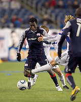New England Revolution midfielder Kenny Mansally (7) dribbles under pressure. The New England Revolution defeated Kansas City Wizards, 1-0, at Gillette Stadium on October 16, 2010.