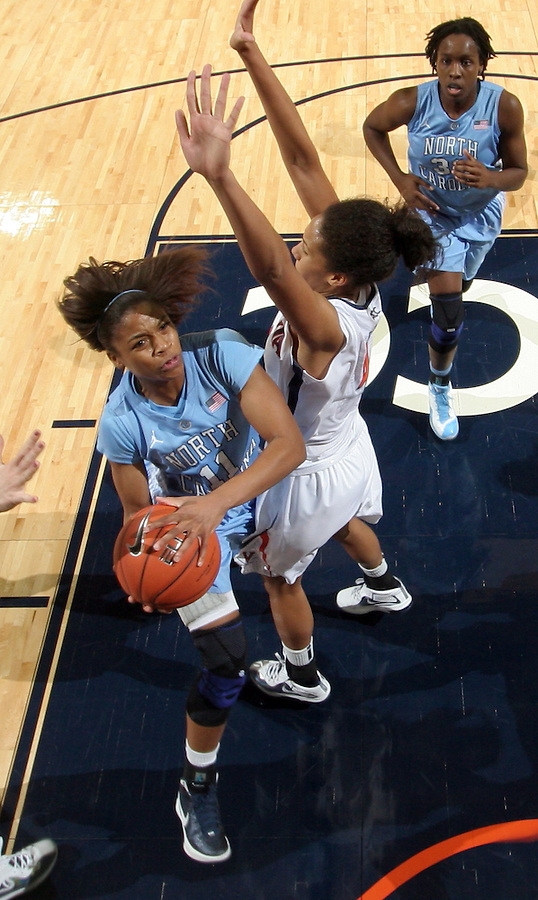 CHARLOTTESVILLE, VA- JANUARY 5: Brittany Rountree #11 of the North Carolina Tar Heels shoots next to Simone Egwu #4 of the Virginia Cavaliers during the game on January 5, 2012 at the John Paul Jones arena in Charlottesville, Virginia. North Carolina defeated Virginia 78-73. (Photo by Andrew Shurtleff/Getty Images) *** Local Caption *** Simone Egwu;Brittany Rountree