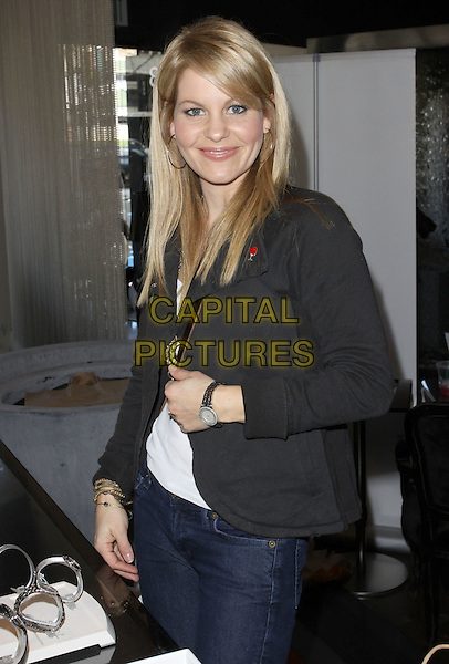 CANDACE CAMERON BURE .Relief Fund Pre-Oscar gifting suite Hosted by Silver Spoon Inc held At Interior Illusion, West Hollywood, California, USA, 4th March 2010..half length black jacket jeans smiling .CAP/ADM/KB.©Kevan Brooks/AdMedia/Capital Pictures.