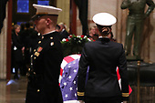The casket of late U.S. President George Bush rests inside the U.S. Capitol Rotunda where it will lie in state in Washington, U.S., December 3, 2018. REUTERS/Jonathan Ernst/Pool