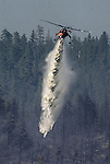 August 22, 2001 Coulterville, California  -- Creek Fire – Erickson Sky Crane drops 2,000 gallons of water on the hot spots on Cuneo Road.  The Creek Fire burned 11,500 acres between Highway 49 and Priest-Coulterville Road a few miles north of Coulterville, California.