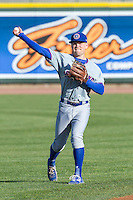 South Bend Cubs shortstop Andrew Ely (8) warms up before the game against the Great Lakes Loons on May 18, 2016 at Dow Diamond in Midland, Michigan. Great Lakes defeated South Bend 5-4. (Andrew Woolley/Four Seam Images)