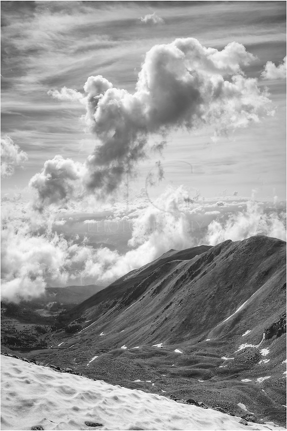 We'd hiked up one of Colorado's 14,000 foot mountains - Mount Columbia. On our return to the car, the clouds started to build below us. The Colorado landscape turned mystical as we looked into the sun. I paused to photograph this black and white Colorado image before we hurried down below tree line - down nearly 2000 vertical feet of loose rock and scree. Yuk! Still, we made it.