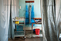 A woman in labor in the delivery room of the labor ward of Arua Hospital, Uganda. There are only 4 beds in delivery room.