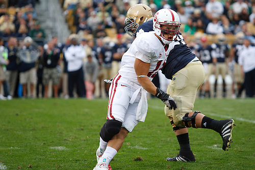 Stanford linebacker Shayne Skov (#11) sheds block during NCAA football game between Stanford and Notre Dame.  The Stanford Cardinal defeated the Notre Dame Fighting Irish 37-14 in game at Notre Dame Stadium in South Bend, Indiana.