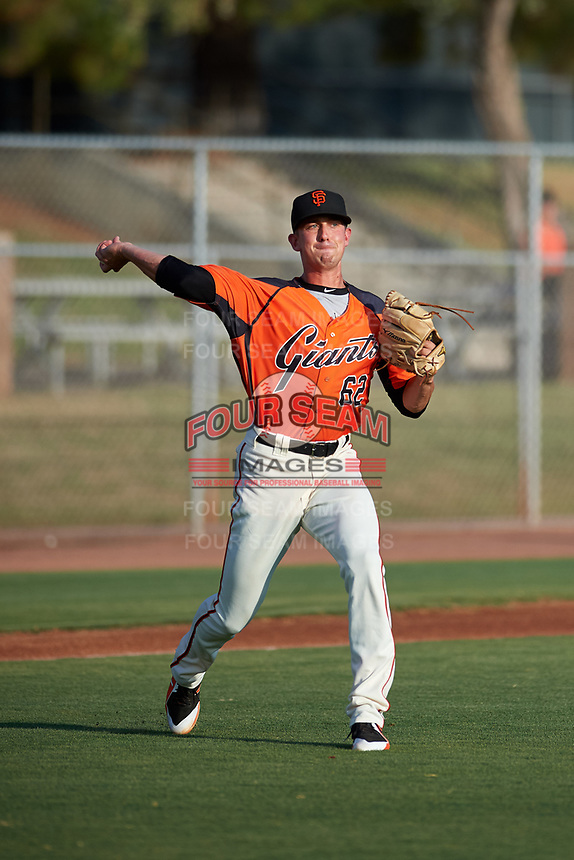 AZL Giants Orange starting pitcher Nick Avila (62) throws to first base during an Arizona League game against the AZL Mariners on July 18, 2019 at the Giants Baseball Complex in Scottsdale, Arizona. The AZL Giants Orange defeated the AZL Mariners 7-4. (Zachary Lucy/Four Seam Images)