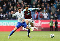 Burnley's Dwight McNeil is tackled by Cardiff City's Sean Morrison<br /> <br /> Photographer Rich Linley/CameraSport<br /> <br /> The Premier League - Saturday 13th April 2019 - Burnley v Cardiff City - Turf Moor - Burnley<br /> <br /> World Copyright © 2019 CameraSport. All rights reserved. 43 Linden Ave. Countesthorpe. Leicester. England. LE8 5PG - Tel: +44 (0) 116 277 4147 - admin@camerasport.com - www.camerasport.com