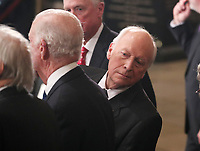 Former U.S. Vice President Dick Cheney looks behind former Secretary of State James Baker as he stands next to former Vice President Dan Quayle (rear) during memorial ceremonies for former President George H.W. Bush in the U.S. Capitol Rotunda in Washington, U.S., December 3, 2018. <br /> CAP/MPI/RS<br /> &copy;RS/MPI/Capital Pictures