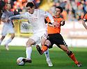 Aberdeen's Scott Vernon is challenged by United's Mark Millar ...