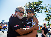 Jun 12, 2016; Englishtown, NJ, USA; Gary Pritchett celebrates with father Bear Pritchett after NHRA top fuel driver Steve Torrence wins the Summernationals at Old Bridge Township Raceway Park. Mandatory Credit: Mark J. Rebilas-USA TODAY Sports
