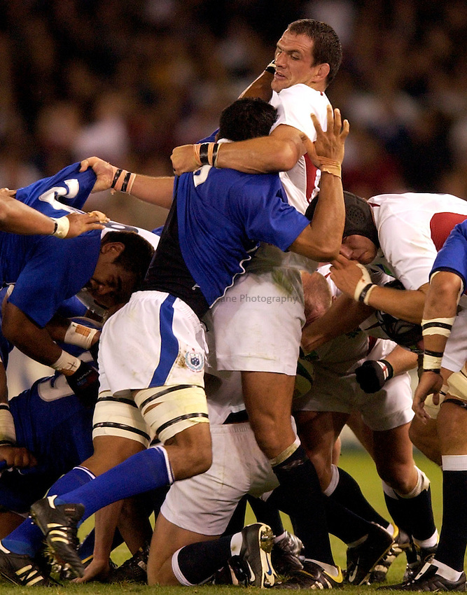 Photo: Richard Lane..England v Samoa, Pool C at the Telstra Dome, Melbourne. RWC 2003. 26/10/2003. .Martin Johnson battles with Leo Lafaili'i.