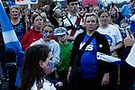 Women and children listening to speeches at a spontaneous event to mobilise support for a pro-independence vote in the Craigmillar district of Edinburgh on the day of the independence referendum. Yes Scotland were campaigning for the country to leave the United Kingdom, whilst Better Together were campaigning for Scotland to remain in the UK. On the 18th of September 2014, the people of Scotland voted in a referendum to decide whether the country's union with England should continue or Scotland should become an independent nation once again and leave the United Kingdom.