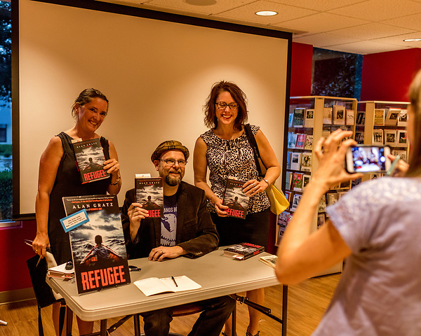 July 26, 2017. Raleigh, North Carolina.<br /> <br /> Alan Gratz poses for a photo with (L to R) Karen Staman and Amy Kurtz Skelding. <br /> <br /> Author Alan Gratz spoke about and signed his new book &quot;Refugee&quot; at Quail Ridge Books. The young adult fiction novel contrasts the stories of three refugees from different time periods, a Jewish boy in 1930's Germany , a Cuban girl in 1994 and a Syrian boy in 2015.