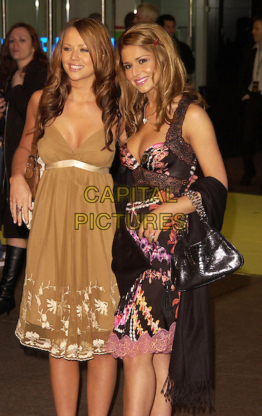 "KIMBERLY WALSH & CHERYL TWEEDY.Arrivals at the World Premiere of ""Alien Autopsy"", .Odeon Leicester Square, London, .England, April 3rd 2006..half length girls aloud green cream patterned dress black pink pashmina wrap bag.Ref: CAN.www.capitalpictures.com.sales@capitalpictures.com.©Can Nguyen/Capital Pictures"
