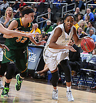 SIOUX FALLS, SD - MARCH 8: Jordan Gilbert #22 of Oral Roberts drives against defender Marena Whittle #32 of North Dakota State in the first half of their first round Summit League Championship Tournament game Sunday afternoon at the Denny Sanford Premier Center in Sioux Falls, SD. (Photo by Dick Carlson/Inertia)