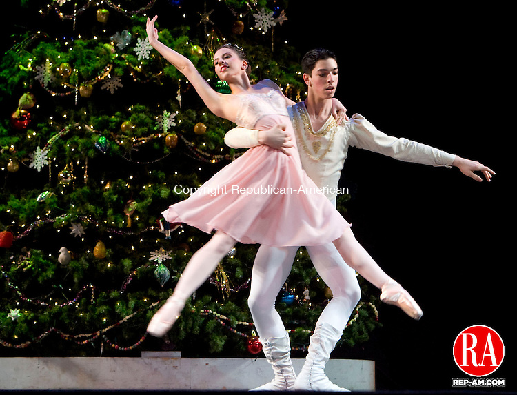 TORRINGTON, CT - 05 DECEMBER 2008 -120708JT25-<br /> Daria Laemmerhirt, playing the character of Adult Clara, dances with Eden Weinstein, playing the character of the Nutcracker Prince, during a dress rehearsal for the Nutmeg Ballet's Nutcracker at Warner Theatre in Torringon on Friday.<br /> Josalee Thrift / Republican-American