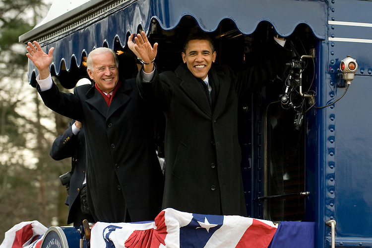 Vice President elect Joe Biden and President elect Barack Obama wave to the crowd gathered at the Edgewood, Md., train station as their train heads from Philadelphia to Washington on Saturday, Jan. 17, 2009, for the Inauguration of the 44th President of the United States.