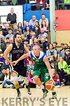 Star, Kieran Donaghy, Garveys Tralee Warriors keeps the ball as far away from Kieran Lacey, Griffith Swords Thunder as he dribbles along the base line in front of a capacity crowd at Tralee sports complex last Saturday night when the sides met in the Super League.
