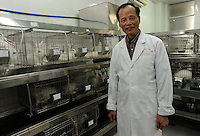 Proff, Chen Xigu, a pioneer in Chinese cloning poses in an animal lab in Guanzhou, China.<br />
