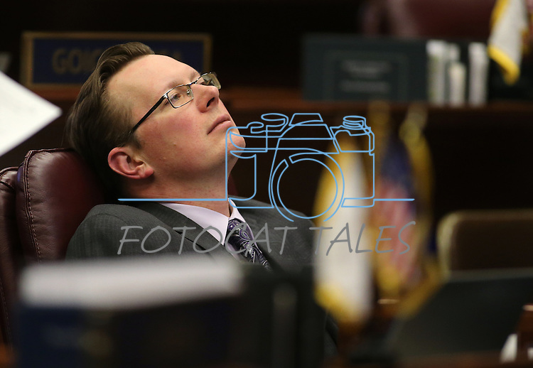 Nevada Sen. Ben Kieckhefer, R-Reno, works on the Senate floor during a special Legislative session in Carson City, Nev., on Tuesday, June 4, 2013. <br /> Photo by Cathleen Allison