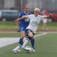 Seattle Reign FC midfielder Megan Rapinoe (15) controls the ball at midfield as Boston Breakers defender Rhian Wilkinson (7) defends. In a National Women's Soccer League (NWSL) match, Seattle Reign FC (white) defeated Boston Breakers (blue), 2-1, at Dilboy Stadium on June 26, 2013.