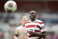 Houston, TX -  Sunday, December 11, 2016: Adrian Alabi (17) of the Stanford Cardinal races for a loose ball in the second half against the Stanford Cardinal at the  NCAA Men's Soccer Finals at BBVA Compass Stadium.