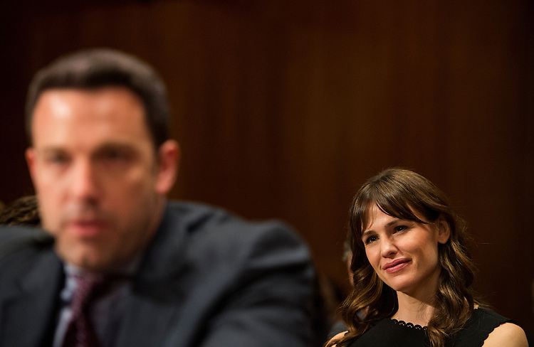 "UNITED STATES - MARCH 26: Jennifer Garner listens as her husband Ben Affleck, actor, filmmaker and founder of the Eastern Congo Initiative, testifies during the Senate Appropriations Committee State, Foreign Operations and Related Programs Subcommittee hearing on ""Diplomacy, Development, and National Security"" on Thursday, March 26, 2015. (Photo By Bill Clark/CQ Roll Call)"