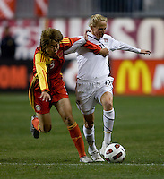 Kristine Lilly (13) of the USWNT fights for the ball with Yu Fan (3) of China during an international friendly at PPL Park in Chester, PA.  The U.S. tied China, 1-1.