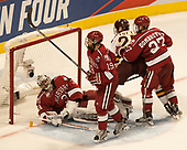 Merrick Madsen (Harvard - 31), Jake Horton (Harvard - 19), Riley Tufte (UMD - 27), Viktor Dombrovskiy (Harvard - 27) - The University of Minnesota Duluth Bulldogs defeated the Harvard University Crimson 2-1 in their Frozen Four semi-final on April 6, 2017, at the United Center in Chicago, Illinois.