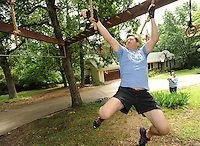 NWA Democrat-Gazette/ANDY SHUPE<br /> The Rev. Steve Sheely, pastor of Rolling Hills Baptist Church in Fayetteville, demonstrates the use of one of the obstacles Wednesday, June 1, 2016, at his Fayetteville home that he trains on while preparing for the races that he takes part in.