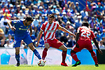 Getafe CF's Jorge Molina and Girona FC's Alex Granell (L) and Seydou Doumbia during La Liga match. May 05,2019. (ALTERPHOTOS/Alconada)
