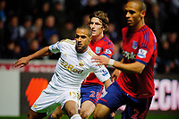 Sunday, 28 November 2012<br /> Pictured:(L-R) Wayne Routledge, Billy Jones, Peter Odemwingie.<br /> Re: Barclays Premier League, Swansea City FC v West Bromwich Albion at the Liberty Stadium, south Wales.