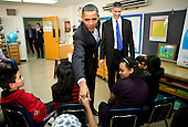 "United States President Barack Obama and U.S. Secretary of Education Arne Duncan visits with sixth grade students at the Graham Road Elementary School in Falls Church, Virginia on Tuesday, January 19, 2010. Following his meeting with students the President will deliver remarks on his ""Race To The Top"" program and his request for an additional $1.35 billion in 2011 for the program..Credit: Kristoffer Tripplaar / Pool via CNP"