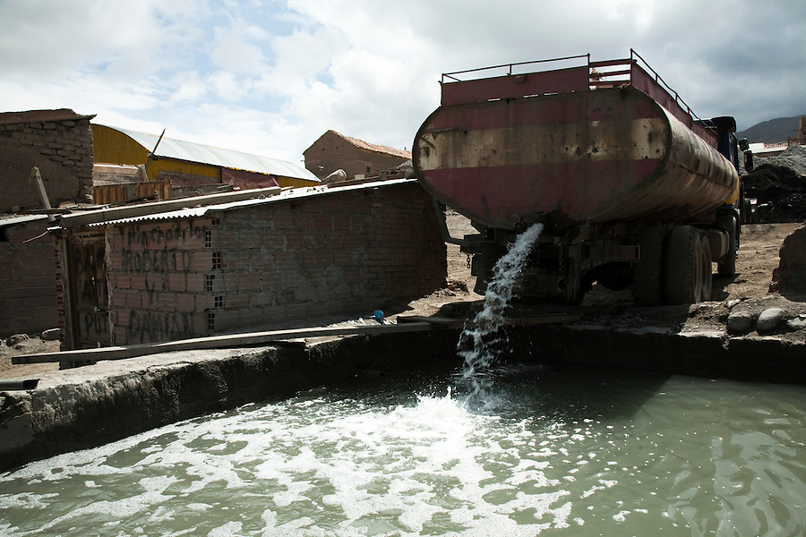 Tanker truck dumping water at an ingenio, or smelting facility, in Potosí.