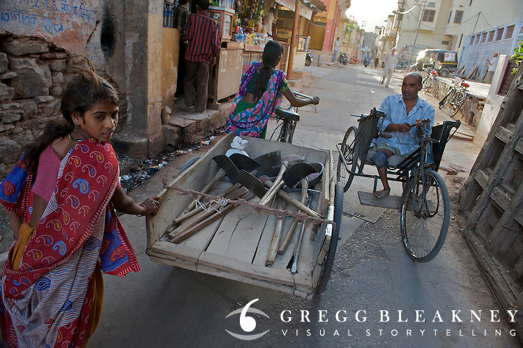 A street scene.  The abundance of bicycle components and easy repair access has led to bicycle-based designs for disabled people throughout India.