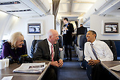 United States President Barack Obama talks with U.S. Senator Patrick Leahy (Democrat of Vermont) and Marcelle Leahy aboard Air Force One en route to Burlington, Vt., March 30, 2012. .Mandatory Credit: Pete Souza - White House via CNP