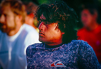 Ross Clarke Jones (AUS), at the opening ceremony of the Quiksilver Eddie  Aikau Big Wave Invitational at Wiamea Bay on Oahu's North Shore in the late 80's. circa 1988. Photo: joliphotos.com